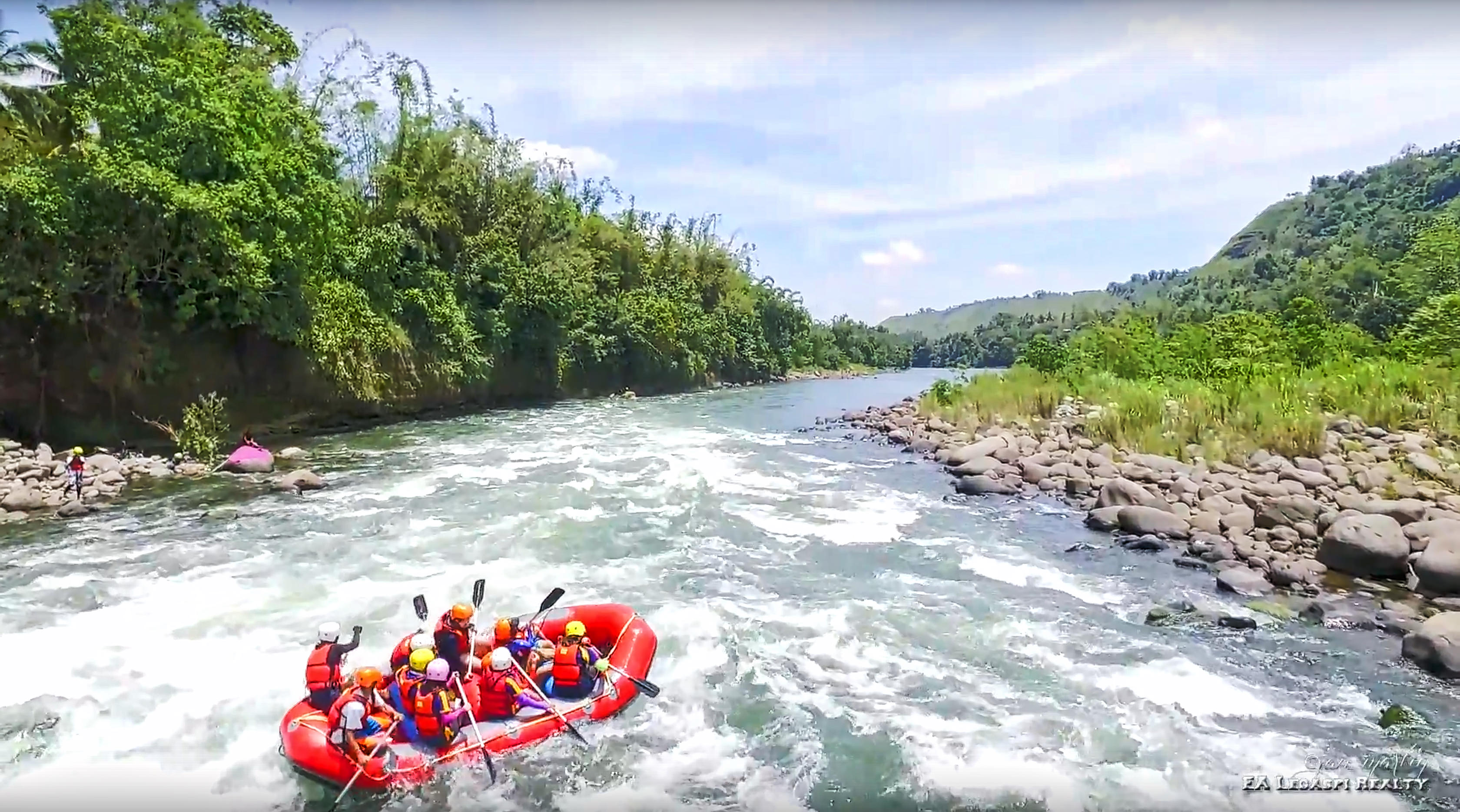 People riding a water rafting boat in Cagayan de Oro