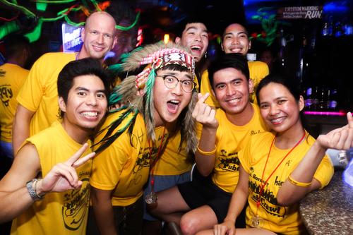 people wearing yellow t-shirts