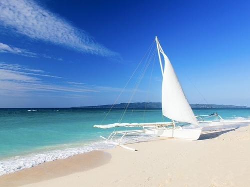 sailboat by the shore in puka beach, caticlan boracay