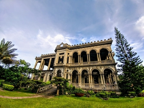 Old Building surrounded by trees in Negros