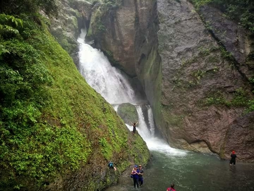 people taking picture of the sayahan waterfall in ormoc